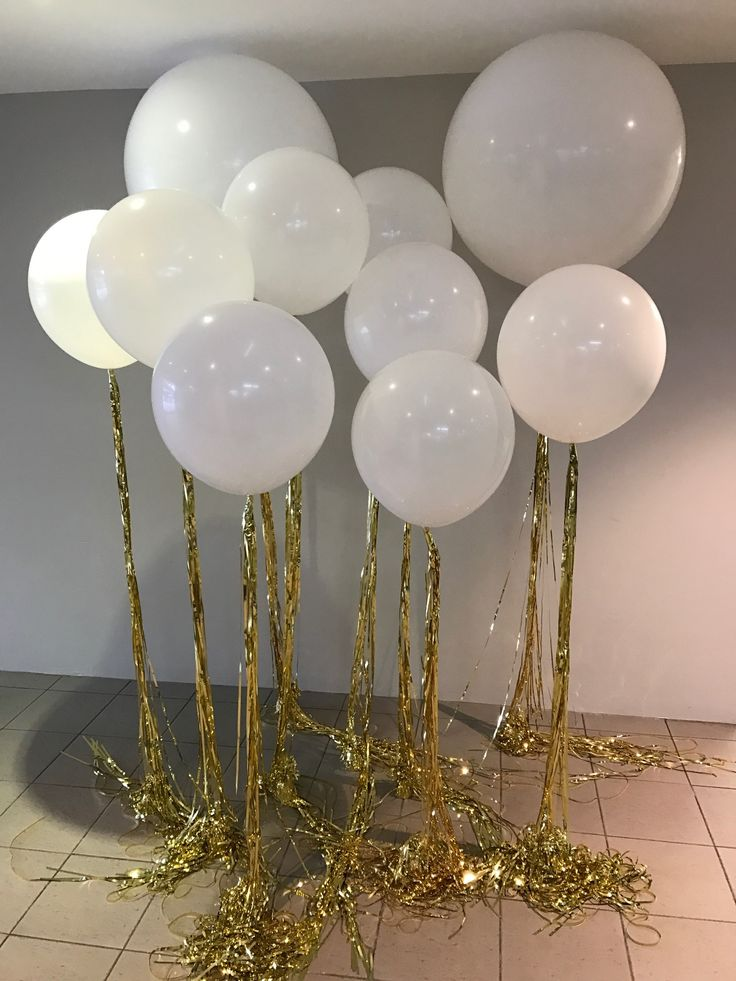 A mix of white round latex balloons with long gold tassel. Please call our store on 9979 6207 for details