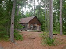 Kitty Lake Ranger Cabin - This hide-a-way on Kitty Lake was my first trip into the Algonquin Provincial Park. It was a short trip in, only had to portage once or twice. It is a good destination for first timers, families with younger kids, or people who just want to escape for a while but don't want to bother with a tent. There is a tradition that was started here and is still carried on. Before you leave you must make something out of natural materials and leave it behind. I left something…