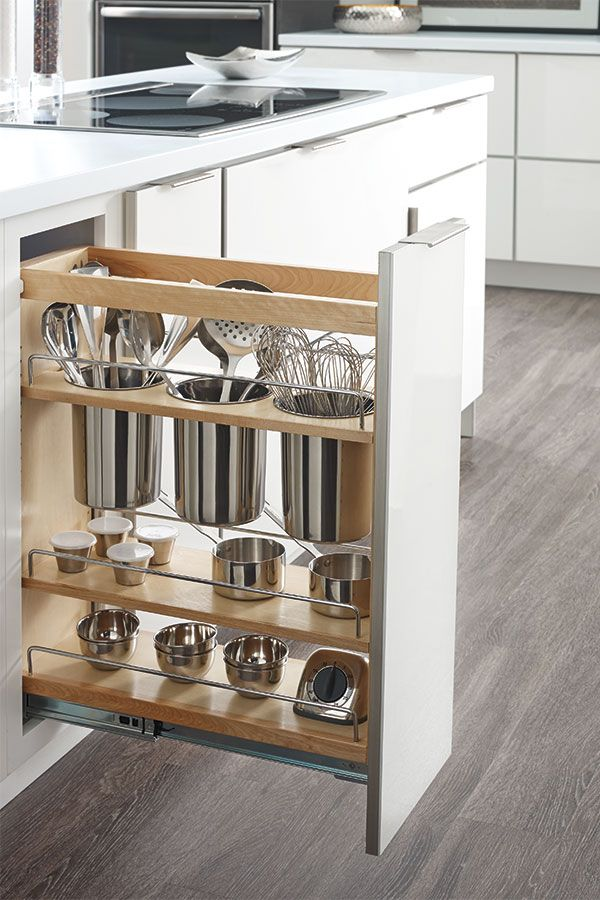 Get more out of minimal space with the Base Utensil Pantry Pullout Cabinet, featuring three open stainless steel canisters.