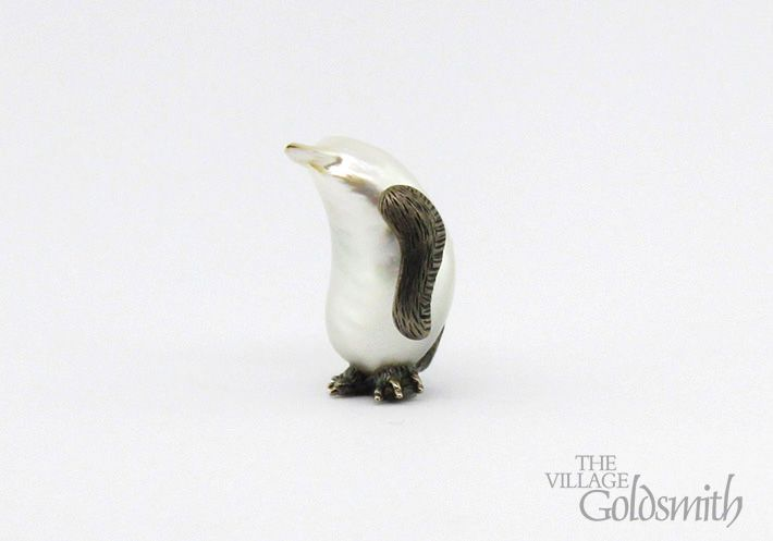 You thought the world's smallest penguin was the Little Blue Penguin but check out this little guy!  Even without the additional details of the wings, feet and tail, this oddly shaped pearl could not be mistaken for anything else.   Handcrafted in The Village Goldsmith's workshop by Steph Lusted.