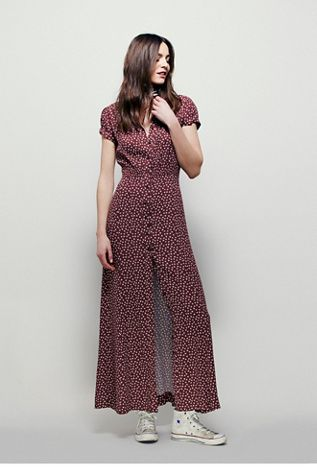 Casablanca Maxi Dress | Free People Retro-inspired printed maxi dress with button detailing down the front and a smocked band at the waist.