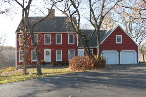 Traditional country setting, the red-barn inspired home.