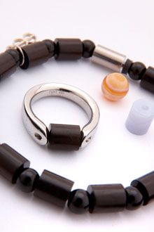 Tipit, Steel jewelry with real stones.