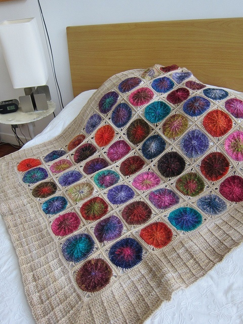 This woman does beautiful work. Im sorry her blog, Little Purl of the Orient, has petered out. But she has two young children and is obviously still knitting! Oops, this is a crocheted project.  Ravelry: littlepurls Sunny Noro