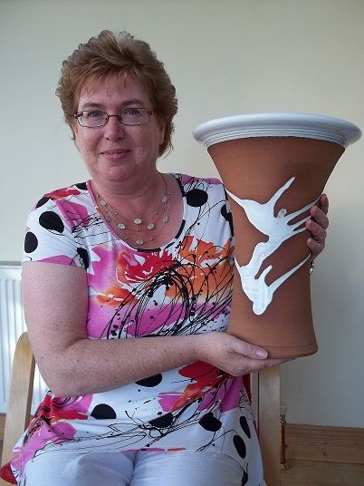 Imelda O'Grady with her Palm Pot by Stephen Pearce Pottery.