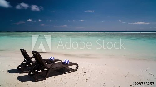 Luxury Beach Chairs And Towels On Tropical Island White Sandy Sunny Day At Private Holiday Honeymoon Resort Tered Clouds