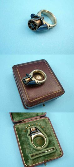 """Ring revolver: This is the truly secret weapon. The magazine on top can be loaded with 7 bullets. ... this one was made in germany and the band is engraved with herringbone borders that say """"femme fatale"""" at the bottom of the ring. guess it was a ladies ring from around the early-to-mid-19th century. mounted on top is a seven-shot cylinder with a fold-down blued trigger and outer spring band. it was on auction and expected to fetch between $2,500 and $4,500 a few years ago."""