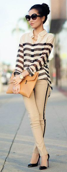 The texture of the loose shirt with stripes goes well with the fitted and striped pants.