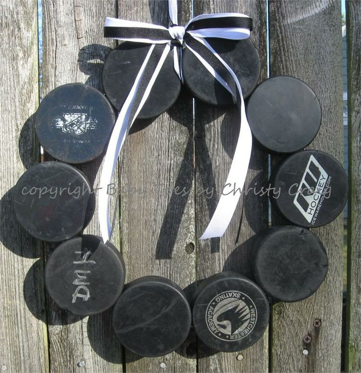 Hockey wreath, one of pucks on the right looks familiar :D www.icewarehouse.com