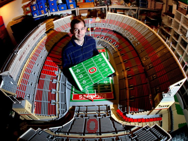 Paul Janssen stands inside the Ohio Stadium he made out of Legos in his basement.