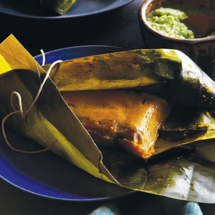 Puerto Rican Pasteles (Pasteles Puertorriqueños) Recipe Main Dishes with tomatoes, green bell pepper, yellow onion, garlic cloves, sweet pepper, tomato sauce, chopped cilantro, culantro, cider vinegar, dried oregano, achiote, bacon, boneless pork shoulder, chicken broth, whole milk, malanga, bananas, green plantains, calabaza, achiote, salt, plantains, achiote, raisins, garbanzo, red bell pepper, pimento stuffed olives