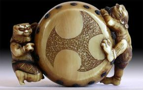 Japanese Coral Inlaid Ivory Netsuke ~ Two Oni Making Big Drum ~ signed Naokazu. Circa: early 19th Century