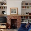 Floating shelves and brick fireplace
