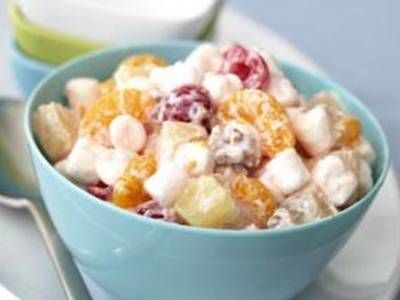 This easy fruit salad combines cut up maraschino cherries, pineapple, and mandarin oranges with tiny marshmallows, walnuts and sour cream.