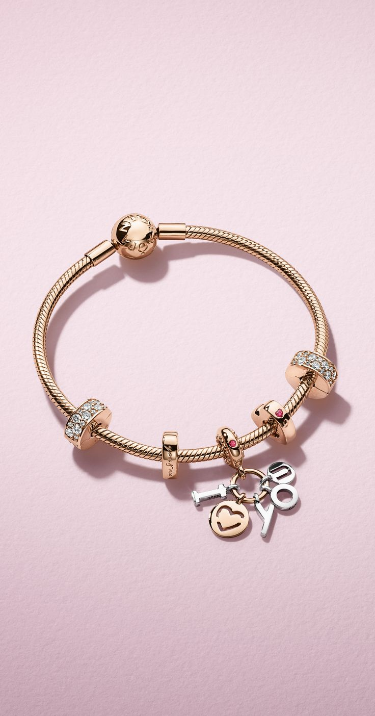 Expertly crafted from sterling silver and our blush-hued metal blend PANDORA Rose, this striking 'I Love You' dangle charm conveys a poignant statement with sleek sophistication, leaving her in no doubt about your loving feelings.
