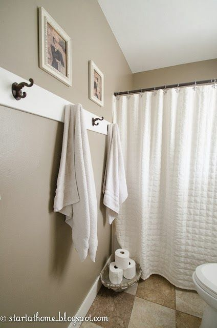 boys bathroom with zen decor love the towel hooks i love this color for though out the house it is warm and light and will stiil brighten up the rooms