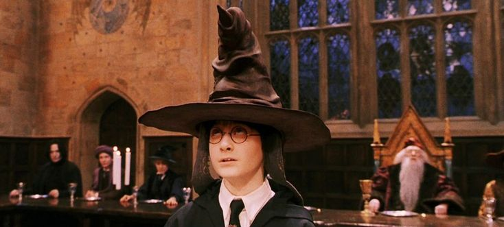The Sorting Hat is a sentient hat at Hogwarts that magically determines which of the four school Houses each new student belongs most to. These four Houses are Gryffindor, Hufflepuff, Ravenclaw, and Slytherin. The Sorting Hat originally belonged to Godric Gryffindor, one of the founders of Hogwarts. It normally stays in the Headmaster's office until it is needed. The famous Hogwarts Sorting Hat gives an account of its own genesis in a series of songs. During the opening banquet at the...