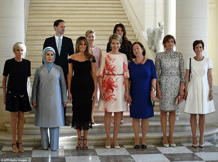 At the palace, Melania posed for photos with (front row from L to R) First Lady of France ...