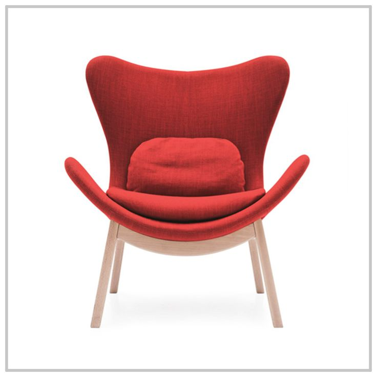 LAZY is an armchair with sinuous lines and a wide, cosy seat, turning it into the perfect companion for your moments of relaxation. A warm invitation to relax on a cold winter afternoon. #chairs #livingroom #interiordesign