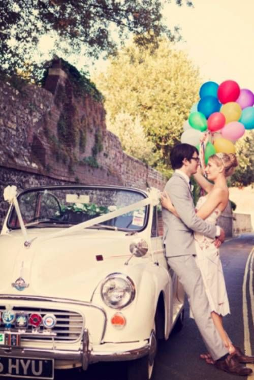 love vintage feel of this wedding shot with balloons