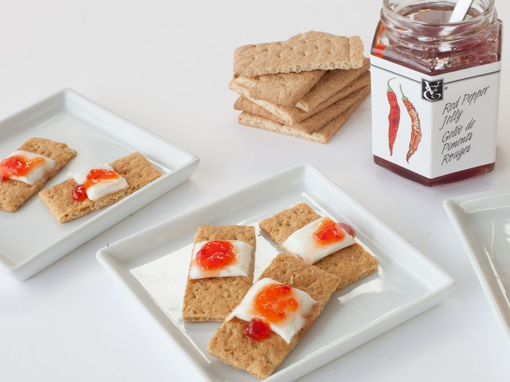 "Band-Aids: This recipe is both delicious and delightfully disturbing! Snap graham crackers in half, smear on some cream cheese, and add a dollop of Red Pepper Jelly on top for the ""eww"" factor. #Halloween"
