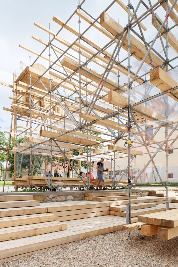 Riga studio Mailītis AIIM has used scaffolding poles, timber planks and corrugated plastic to create this events pavilion – one of three temporary structures built in the grounds of a former brewery in Latvia