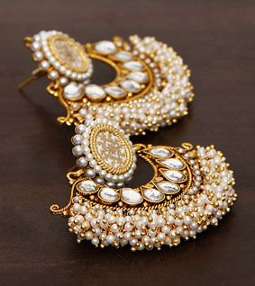 Pearl embellished traditional gold earrings. Indian jewellery.