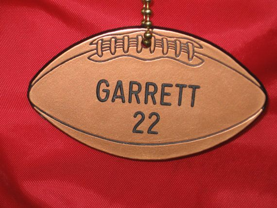 Personalized football bag tags... another one-of-a-kind exclusively from Jym... the originator of personalized sports bag tags.  Wherever Your