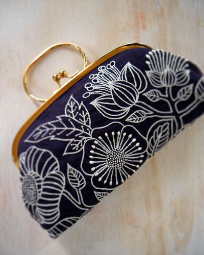 "Yumiko Higuchi is an inspirational embroidery artist I recently discovered. Her work and designs are simple, yet so full. My favorite part is how she turns her embroidery into a ""patterned"" fabric to make clutches. Enjoy!"