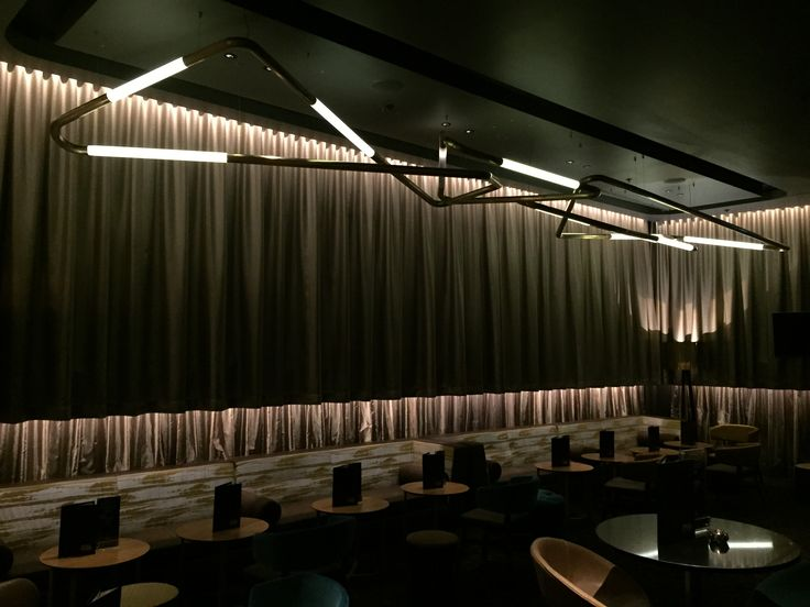 Event Cinemas - Miranda. Custom tube light in antique Brass by Nocturnal Lighting www.ladgroup.com.au