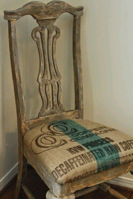 DIY chair idea- take a pained, wooden chair and add a coffee bean sack seat pad. This burlap coffee sack has a wide stripe painted down the center of the cushion. via Alma Cende Inspiraciones, a Blogger blog