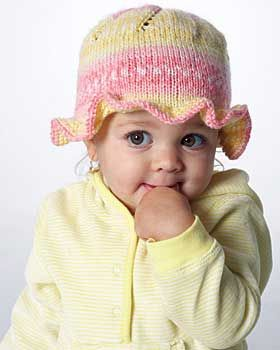 Sweet knit cap features a pretty ruffle around the brim. To fit child sizes 6-24 mos.