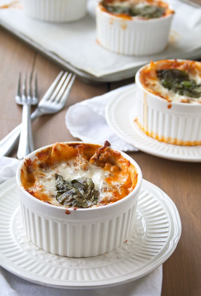 Personalized size ramekins filled with homemade pasta noodles, spicy Italian sausage, fresh-made tomato sauce and cheese – lots and lots of cheese. This is the best lasagna that you'll ever eat!
