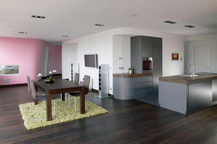 Colorful Loft Design With Wall Integrated Service Spaces Home - Colorful loft design with unique wall structure stargarder strasse by graft