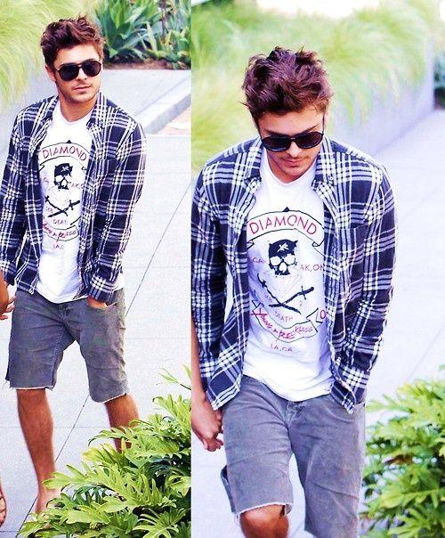 Zac Efron's style: graphic Tshirt, plaid shirt and shorts