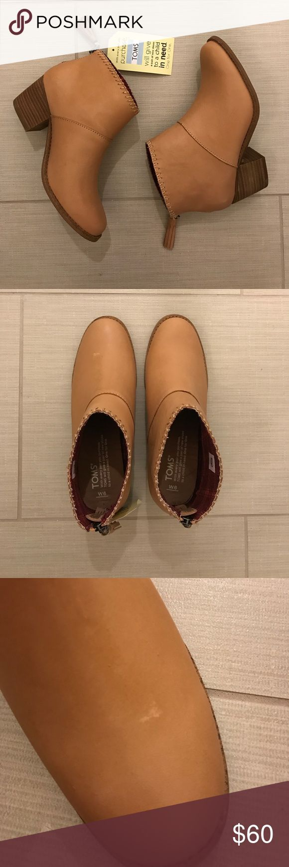 TOMS boots Brand NEW and NO trades please. Slight tiny discoloration on the left side as shown in the pic. TOMS Shoes