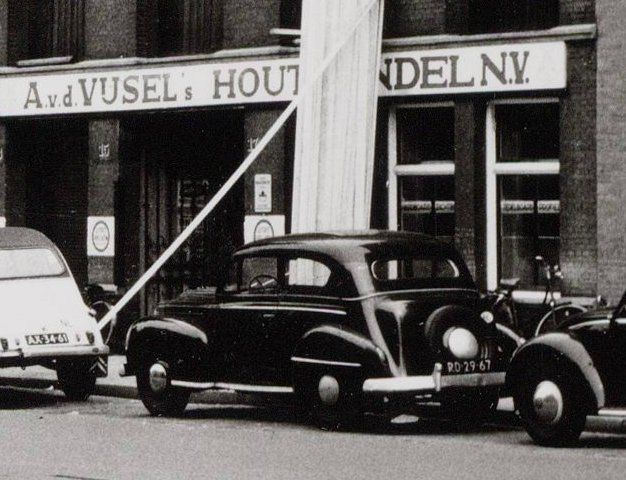 1960's. Citroën 2CC (AX-34-61) and an Opel Olympia (RD-29-67) parked in front of Houthandel A. v. d. Vijsel on the Overtoom in Amsterdam. #amsterdam #1960 #overtoom