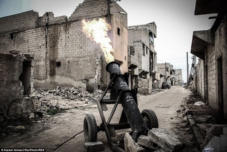 A shell is fired from the homemade weapon known as a 'hell cannon' by rebels from the Free...
