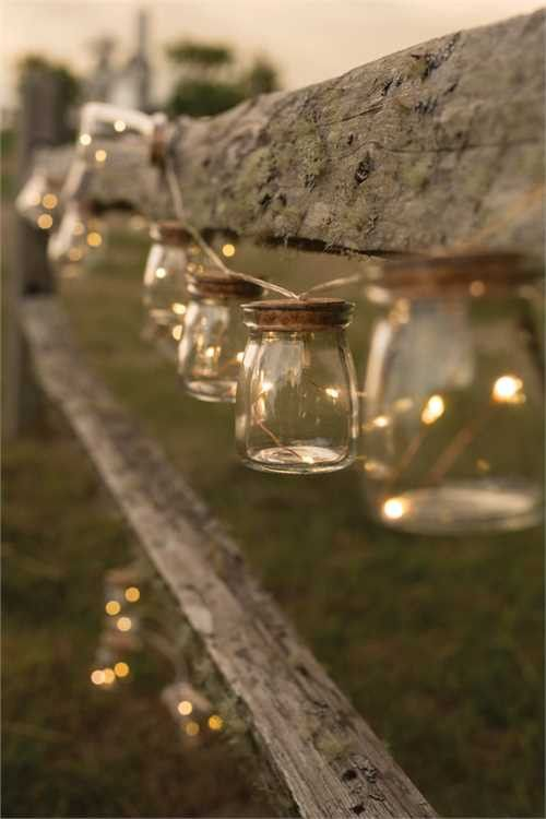 "Illuminate a room or setting with this charming firefly light strand. Twinkling LED lights inside small glass jars sealed with corks. - Small glass jars with blinking firefly led lights. - 51"" long li"