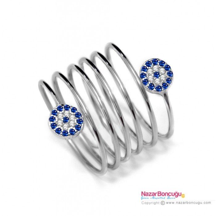 Spiral Gümüş Yüzük - Spiral yüzük modelleri arasında, zirkon taşlarla kaplı nazar boncukları ile spiral şeklinde dizayn edilmiş farklı bir model. Nazar boncuklu yüzükler her zaman moda. Nazar Boncuğu Resimleri