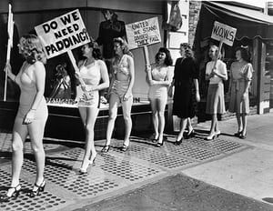 23 August 1947: Members of the Women's Organisation to War on Styles (WOWS) picket a dress shop in Berkeley in protest at longer skirts and padded hips. They are the wives of GI students at the University of California. Left to right: Jackie Houser, Wanda Ames, Dorothy Inman, Terry Ligon, Ruth Van Arkel, Carrol Reynolds and Barbara Carmichael