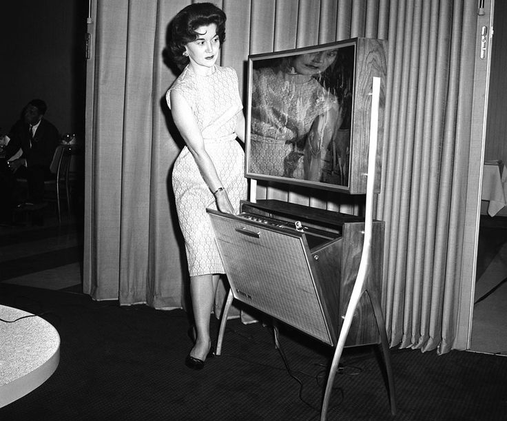 Caption from 1961: TV viewers of the 1970s will see their programs on sets quite different from today's, if designs now being worked out are...