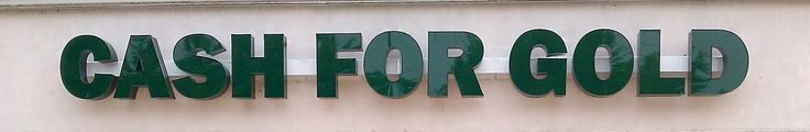 Storefront LED Channel Letter Sign with a bronze return, face and trim color dark green with a white raceway.