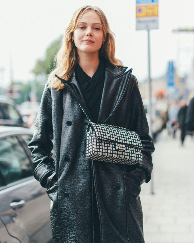 Frida Gustavsson wearing HOPE Steel Coat Patent Black during Fashion Week Stockholm