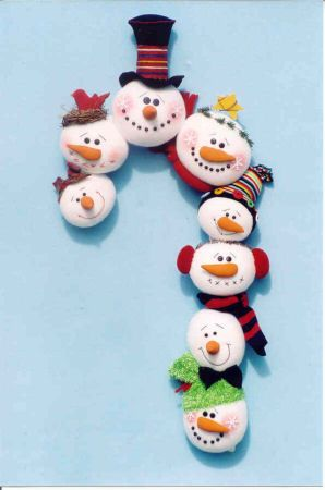 """14"""" x 26"""" Snowball Candy Cane made from fleece circle snowman faces mounted on a cardboard or wire frame."""