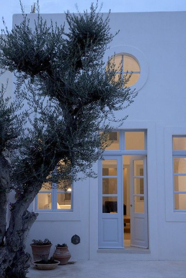 A pair of modest French doors mark the entrance to this gorgeous Santorini villa. The Dpages. Photo via HomeAway.