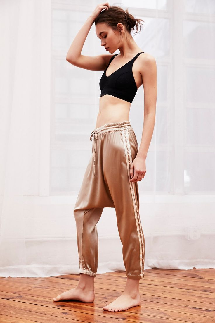 Alix Silk Harem Pant | Ultra luxe silk harem pants featured in a classic sporty track style with stripe details along the sides.    * Cropped fit with elastic at the ankle   * Drawstring waist