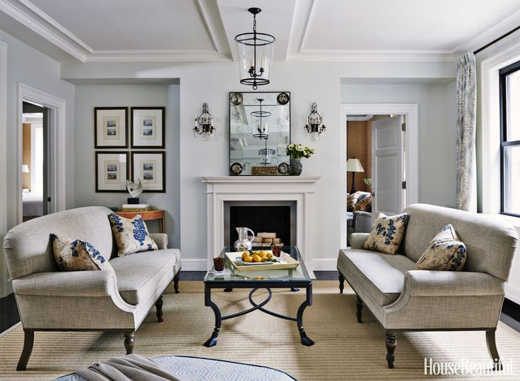 Symmetry And Soothing Colors Maintain Peace In This Manhattan Living Room
