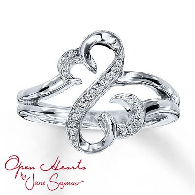 From the Open Hearts by Jane Seymour® collection. The iconic Open Hearts design is decorated with brilliant round diamonds set in sterling silver in this irresistible diamond ring for her. Total diamond weight is one-twentieth carat. [The perfect purity ring]