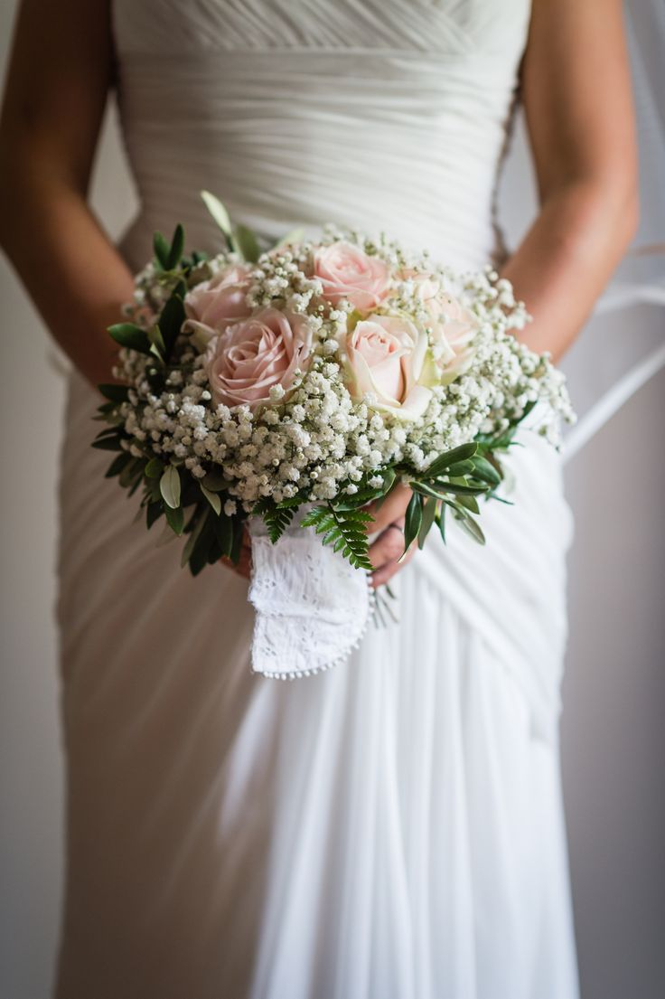 Stunning bouquet of antique pink roses, gypsophila and olive branches. Wrapped in vintage broderie anglaise from my nano's (nanna's!) wedding dress. Wedding day at Villa Nozzole. Tuscany, Italy